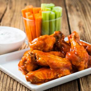 Buffalo sauce over fried jumbo wings