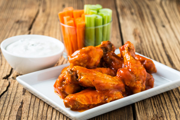 Buffalo sauce over fried jumbo wings
