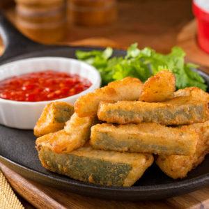 Zucchini sticks breaded and fried
