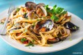 Linguini noodles with celery, red onions and garlic in white clam sauce