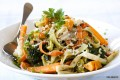 Fettuccini pasta tossed in a light cream sauce with chicken and sauteed vegetables