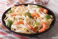 Fettuccine with sauteed shrimp, scallops and mushrooms in alfredo sauce