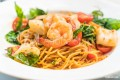 Angel hair with sauteed shrimp, celery, red onions, capers and a splash of white wine tossed in spicy marinara sauce. Spicy